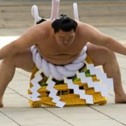Mongolian-born grand sumo champion Yokozuna Hakuho performs the New Year's ring-entering rite at the annual celebration for the New Year at Meiji Shrine in Tokyo January 7, 2015. REUTERS/Thomas Peter (JAPAN - Tags: SPORT RELIGION SOCIETY)